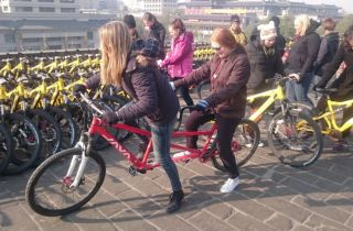 Brittany and Kathrin attempting a tandem bike on the City Wall