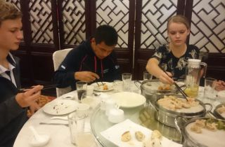 Mick, Reego and Kathrin enjoying their dumpling