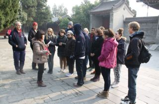 Mei recounting the history of the Pagoda